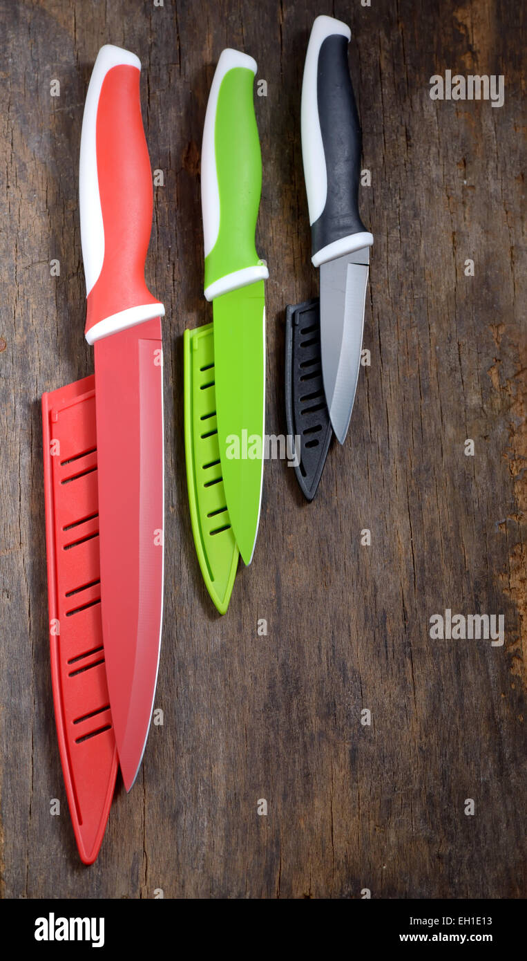 ceramic knifes on old wooden table - Stock Image