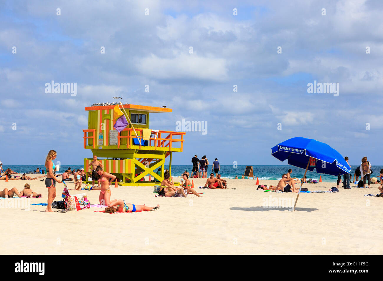 Tourists sunbathing on South Beach, Miami, Florida, USA - Stock Image
