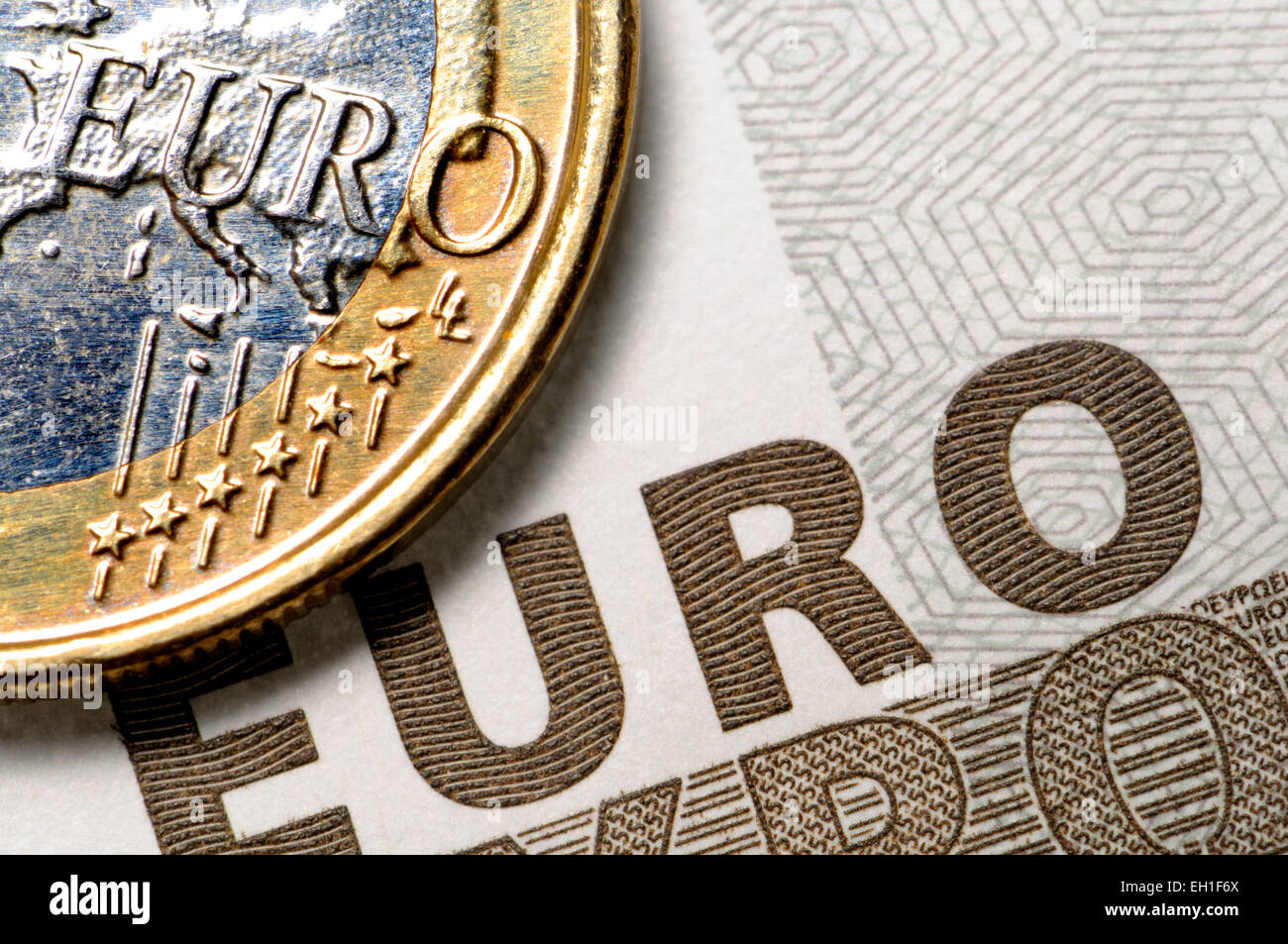 Euro coin and €5 note - Stock Image
