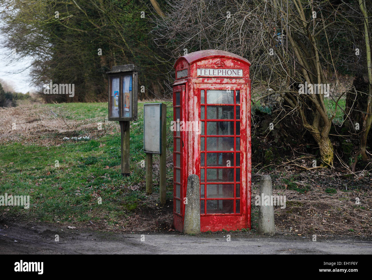 Traditional red telephone box in a rural Norfolk village. - Stock Image