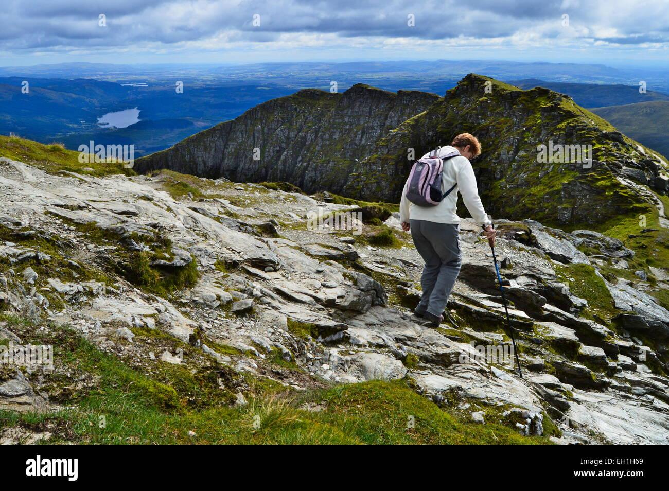Woman walking down south side of Ben lomond, Scotland - Stock Image