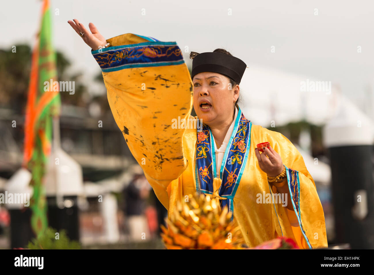 A priest blessing the waters during the Taoist ceremony eye dotting dragon boats to ensure a safe weekend of racing. - Stock Image