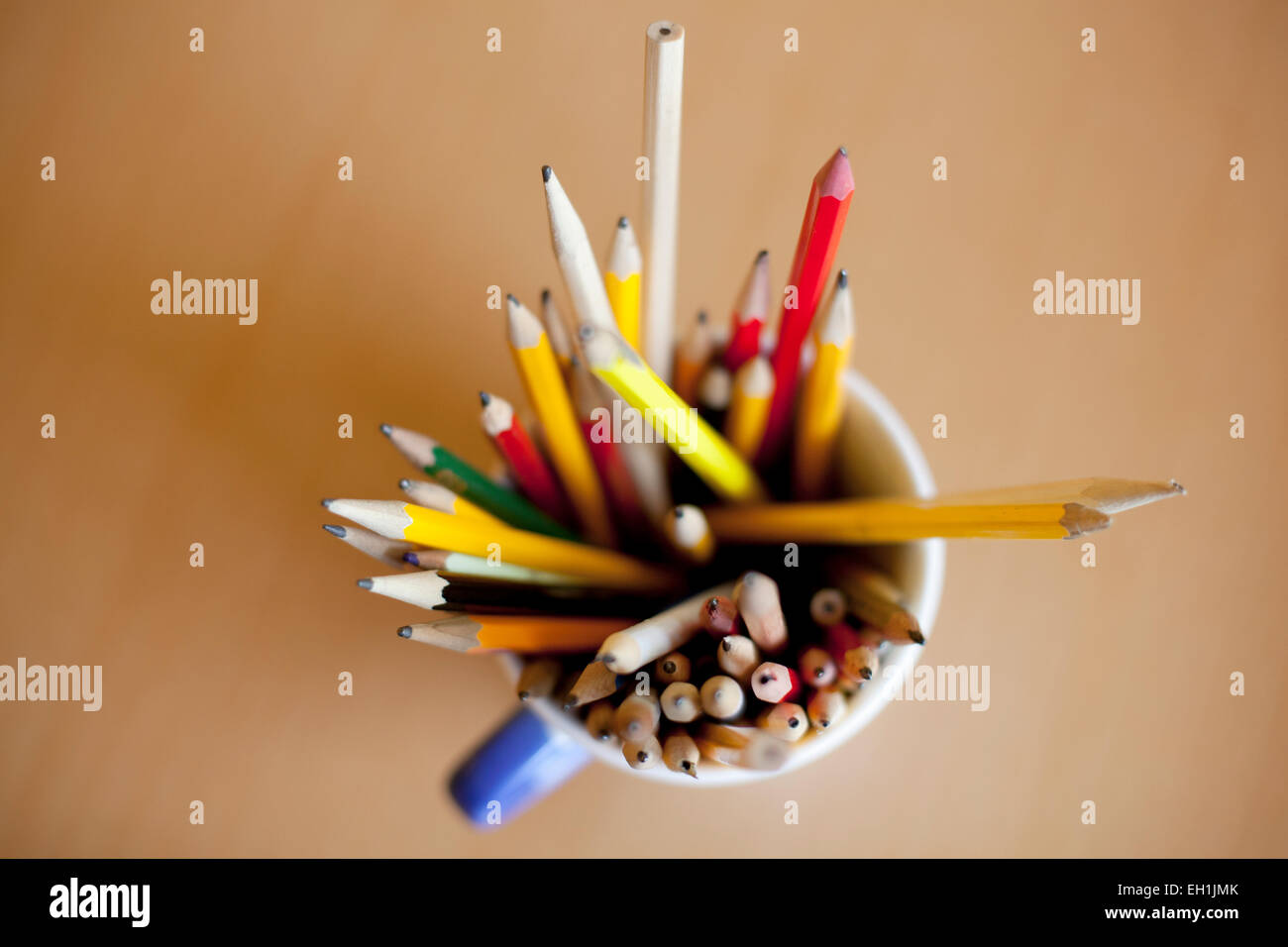 Directly above shot of pencils in desk organizer on table - Stock Image