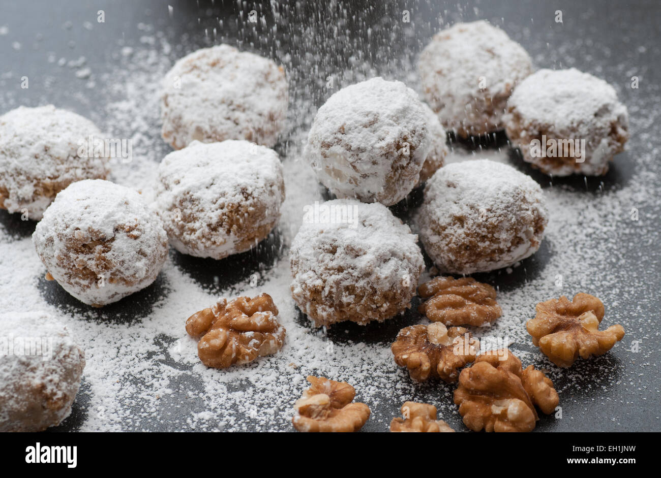Homemade walnut snowball cookies with powdered sugar. - Stock Image
