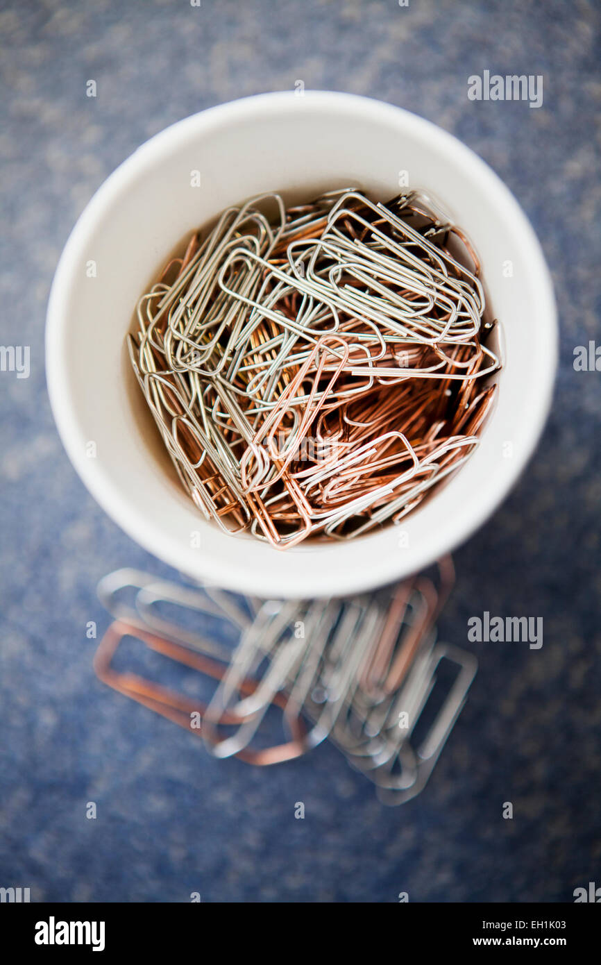 Close-up of a container filled with paper clips - Stock Image