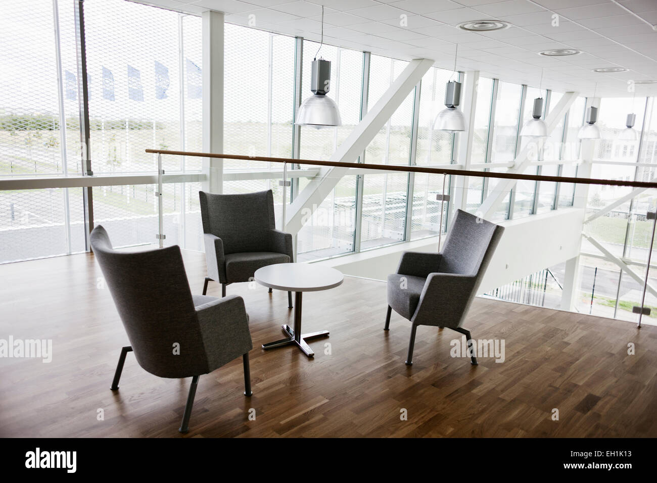 Empty chairs and table in contemporary office - Stock Image