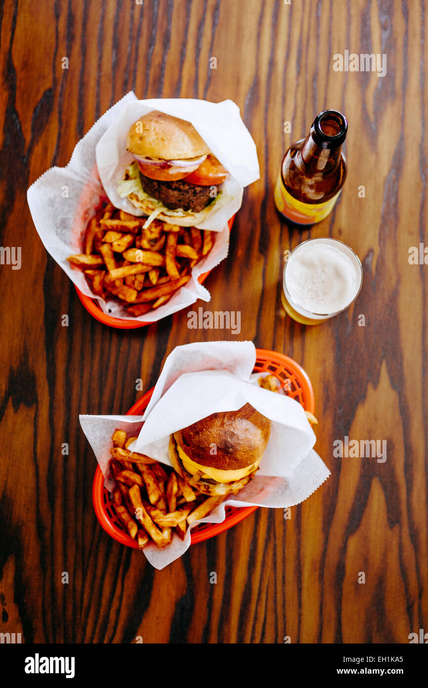 Directly above shot of fast foods served with beer on restaurant table Stock Photo