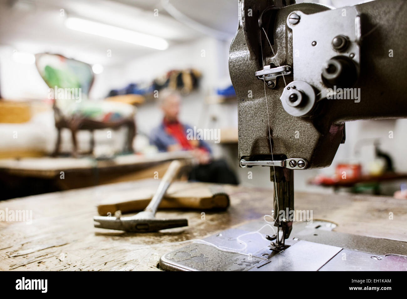 Sewing machine in furniture making factory - Stock Image