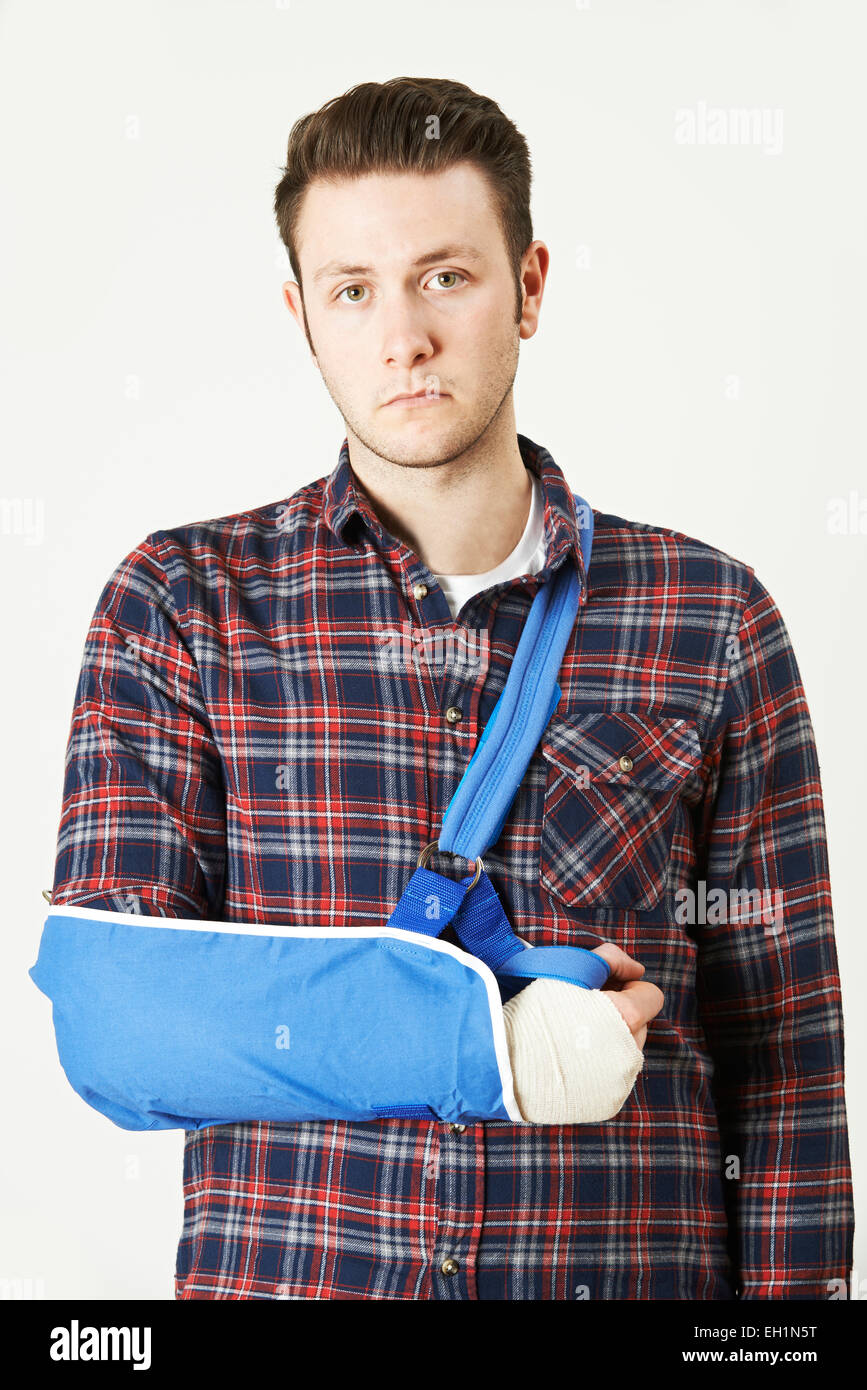 Portrait Of Young Man With Arm In Sling - Stock Image