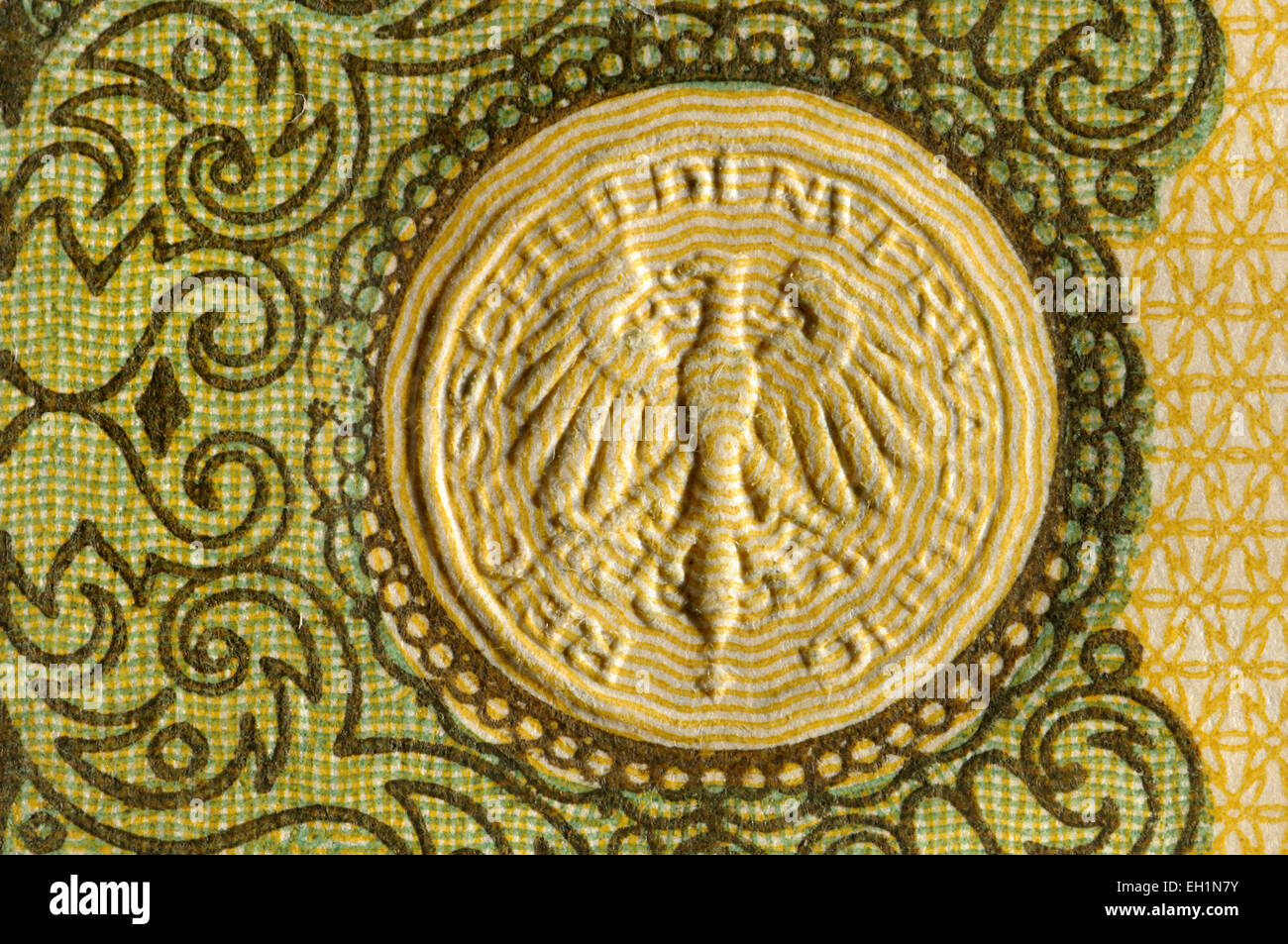 Detail from a 1914 German 1 Mark banknote showing raised embossed security feature - Stock Image
