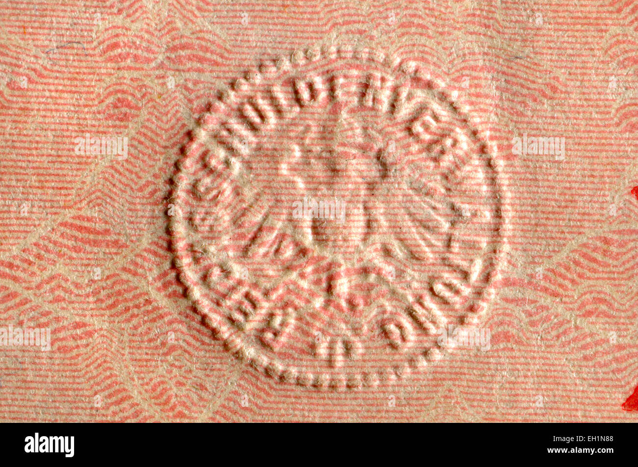 Detail from a 1914 German 2 Mark banknote showing raised embossed security feature - Stock Image