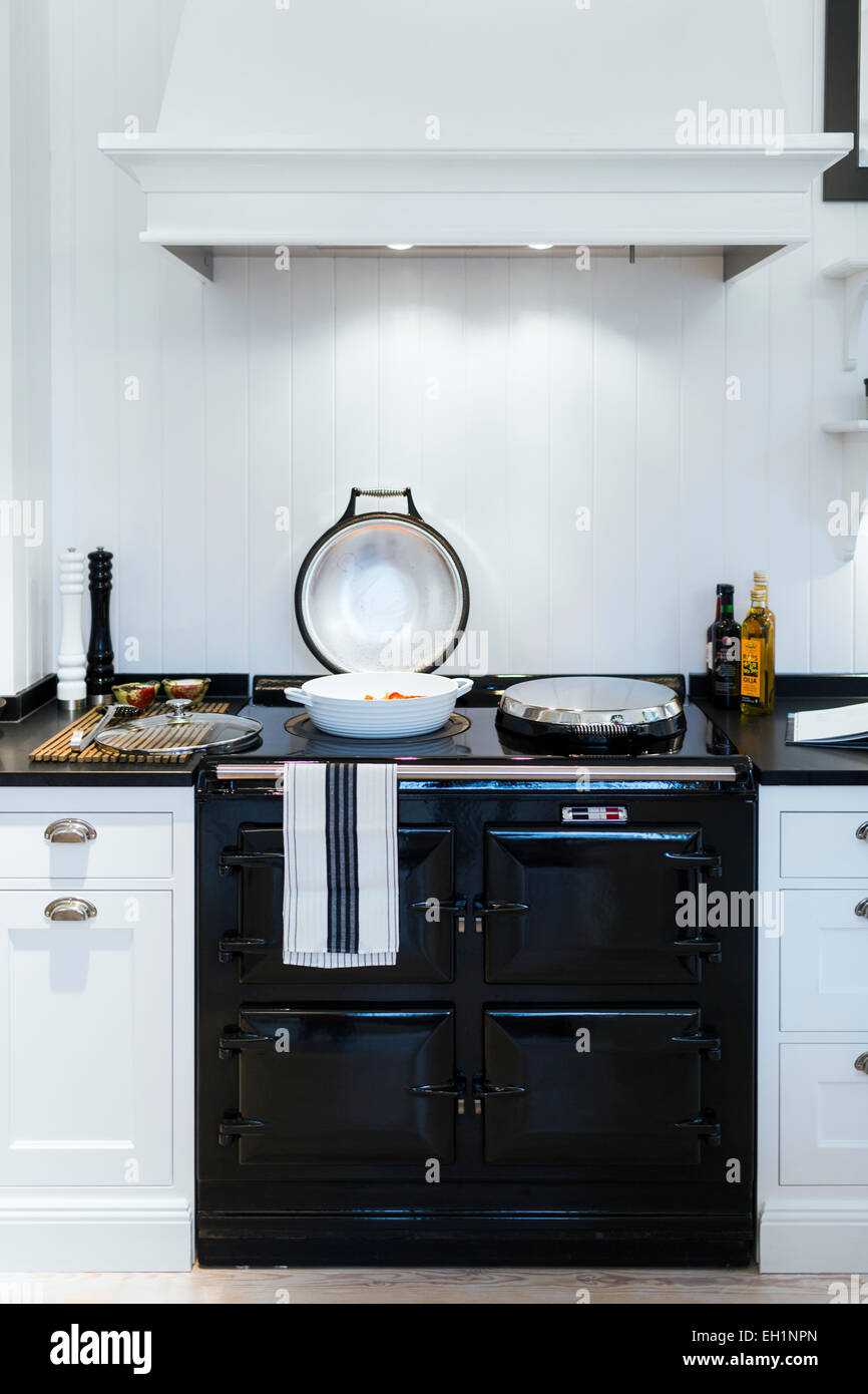 Cooking pan on stove in domestic kitchen - Stock Image