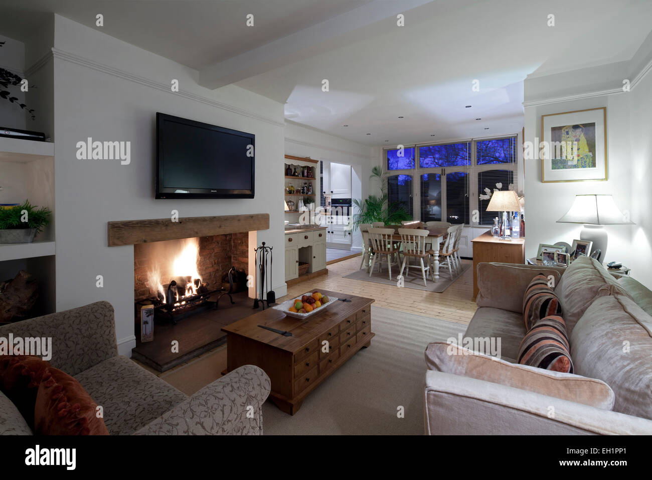 Open Plan Living And Dining Room With Plasma Screen Above Fireplace In Macclesfield Townhouse Cheshire England UK