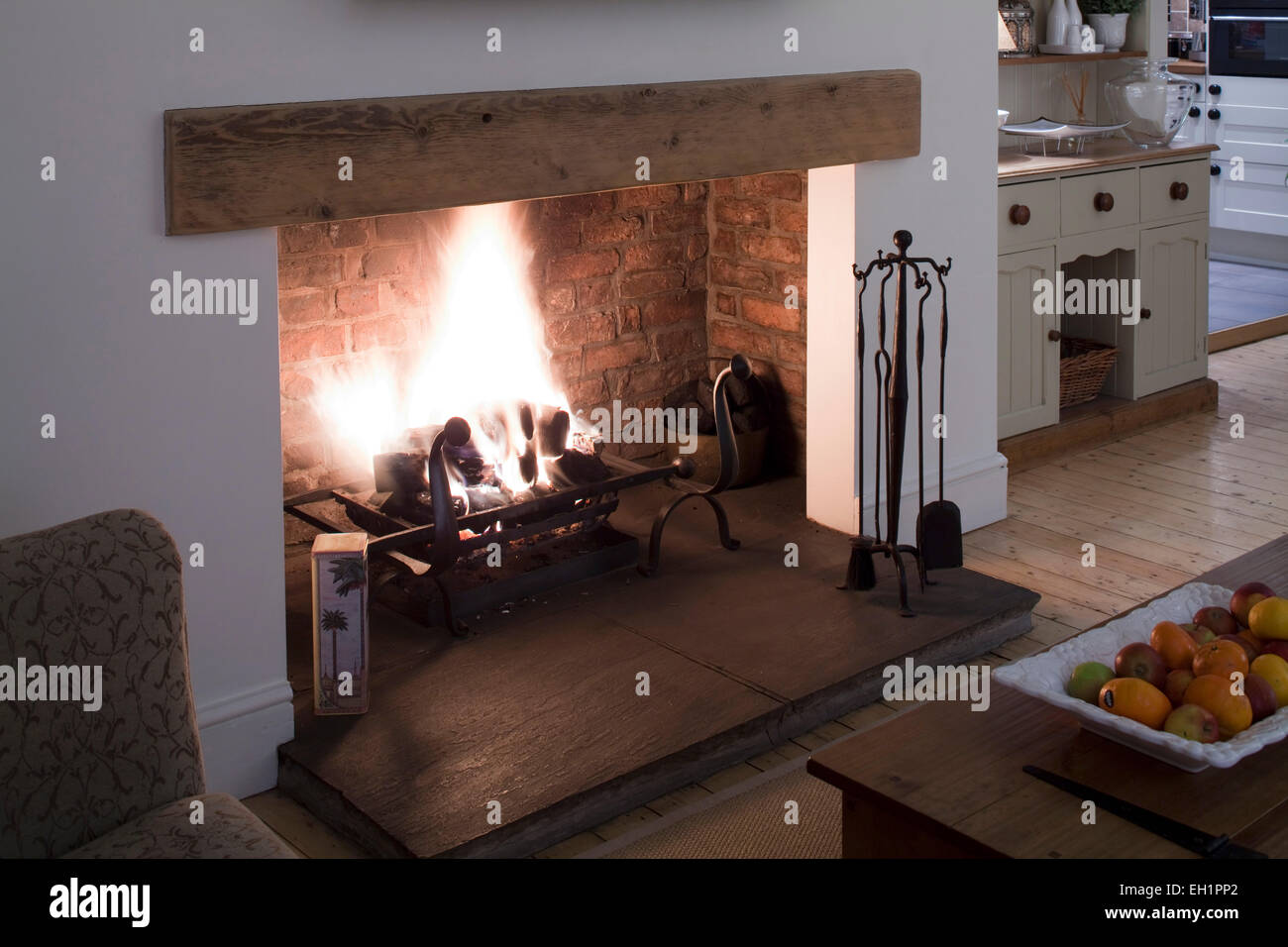 Open Fire In Living Dining Room Of Macclesfield Townhouse Cheshire England UK