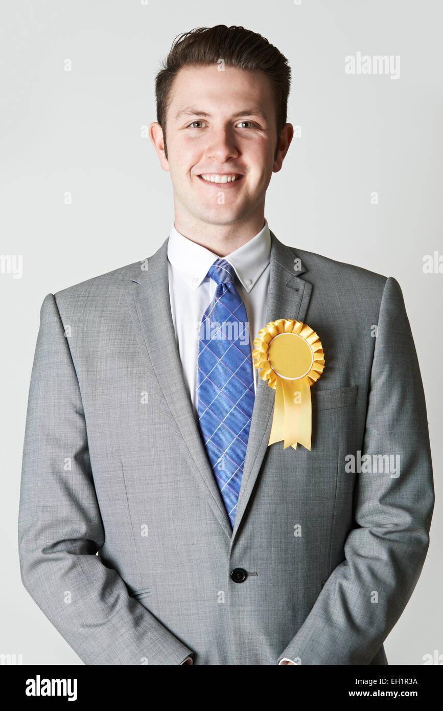 Portrait Of Politician Wearing Yellow Rosette - Stock Image