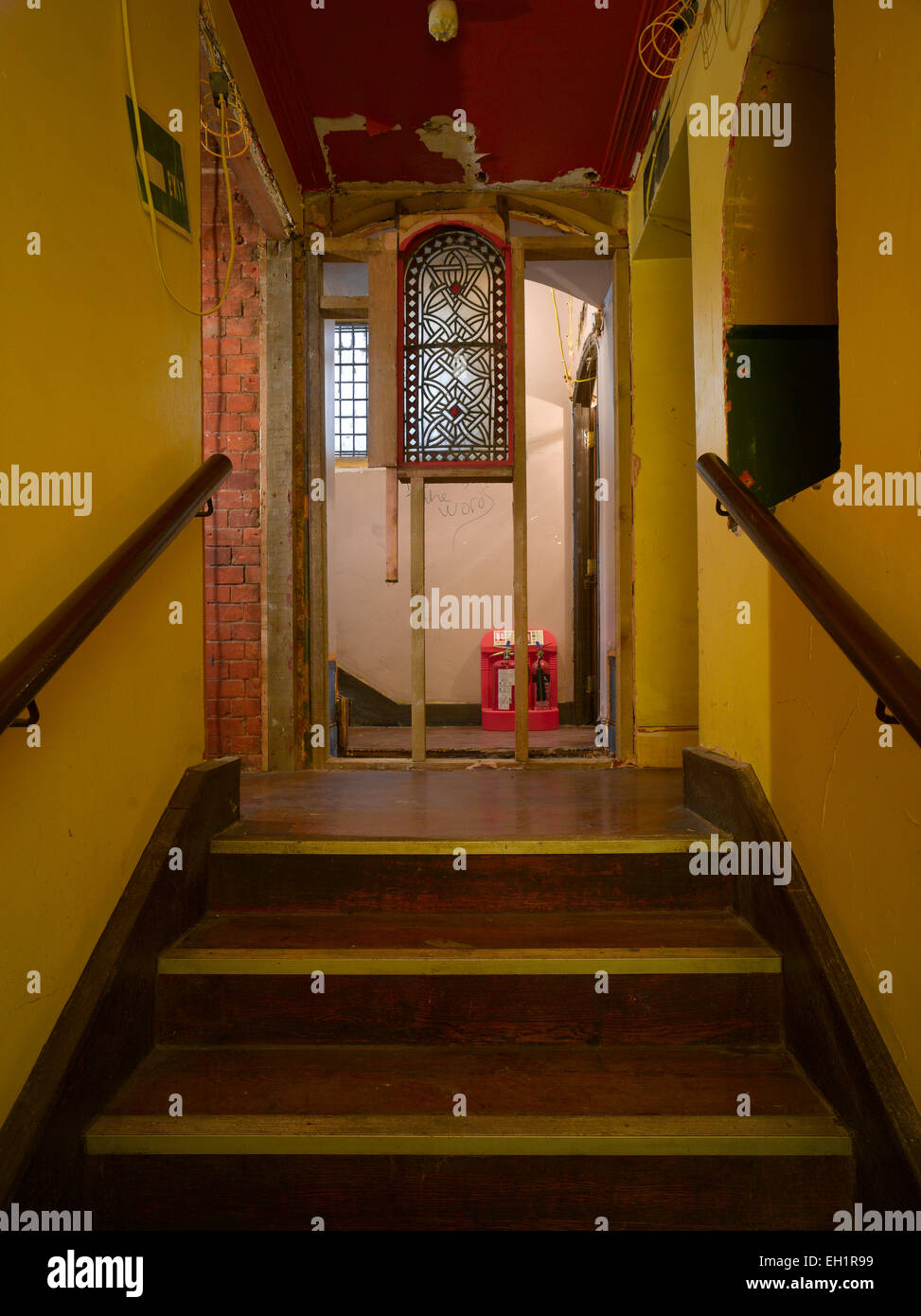 Half built partition with stained glass window at top of staircase during renovation, Welsh Chapel, London, UK - Stock Image