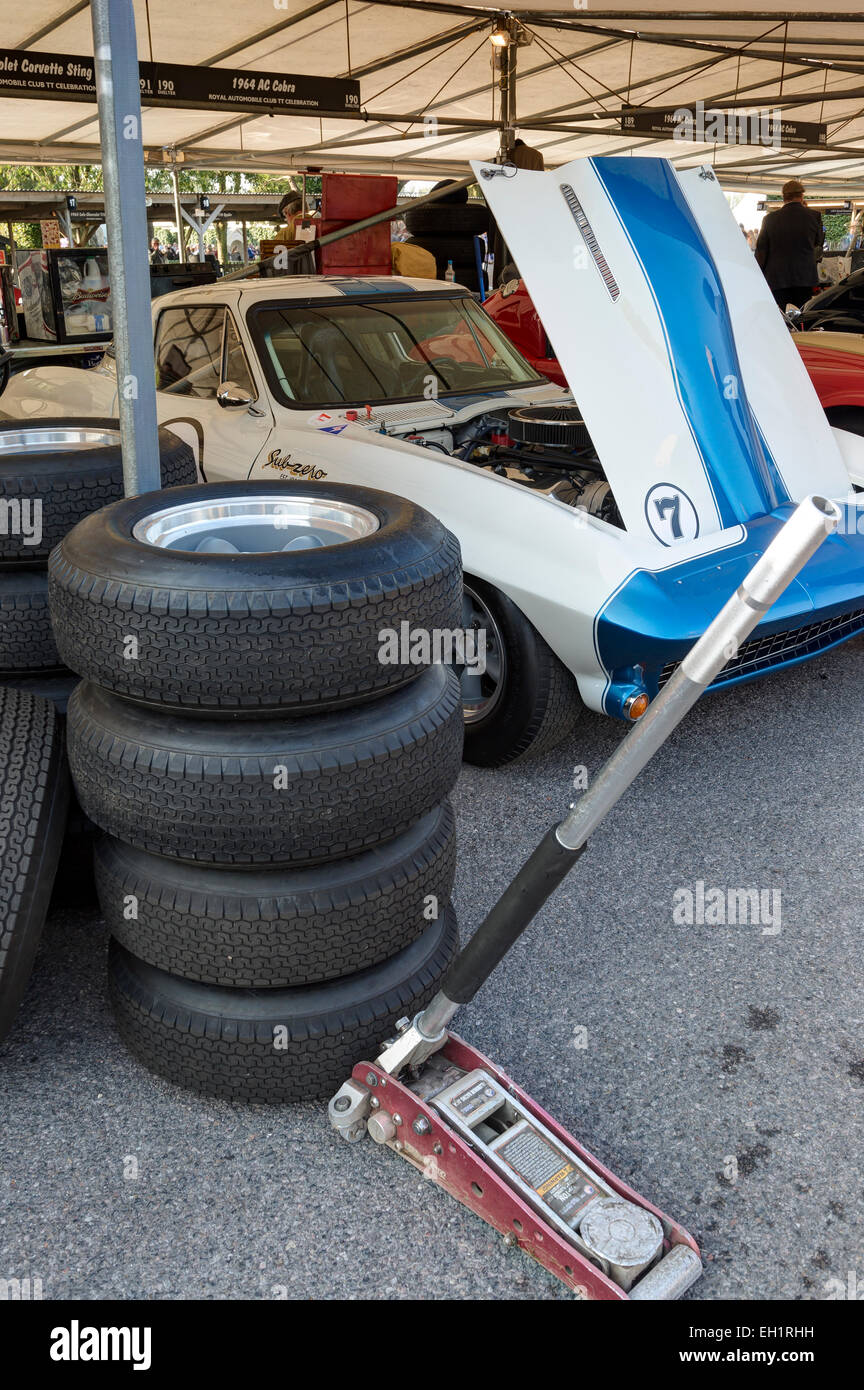 Tyres are readied for the 1965 Chevrolet Corvette Stingray in the paddock, 2014 Goodwood Revival, Sussex, UK. - Stock Image