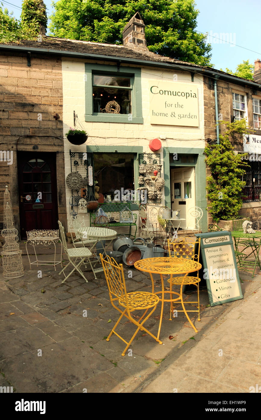 Antique garden furniture outside a shop, Hebden Bridge, West Stock ...