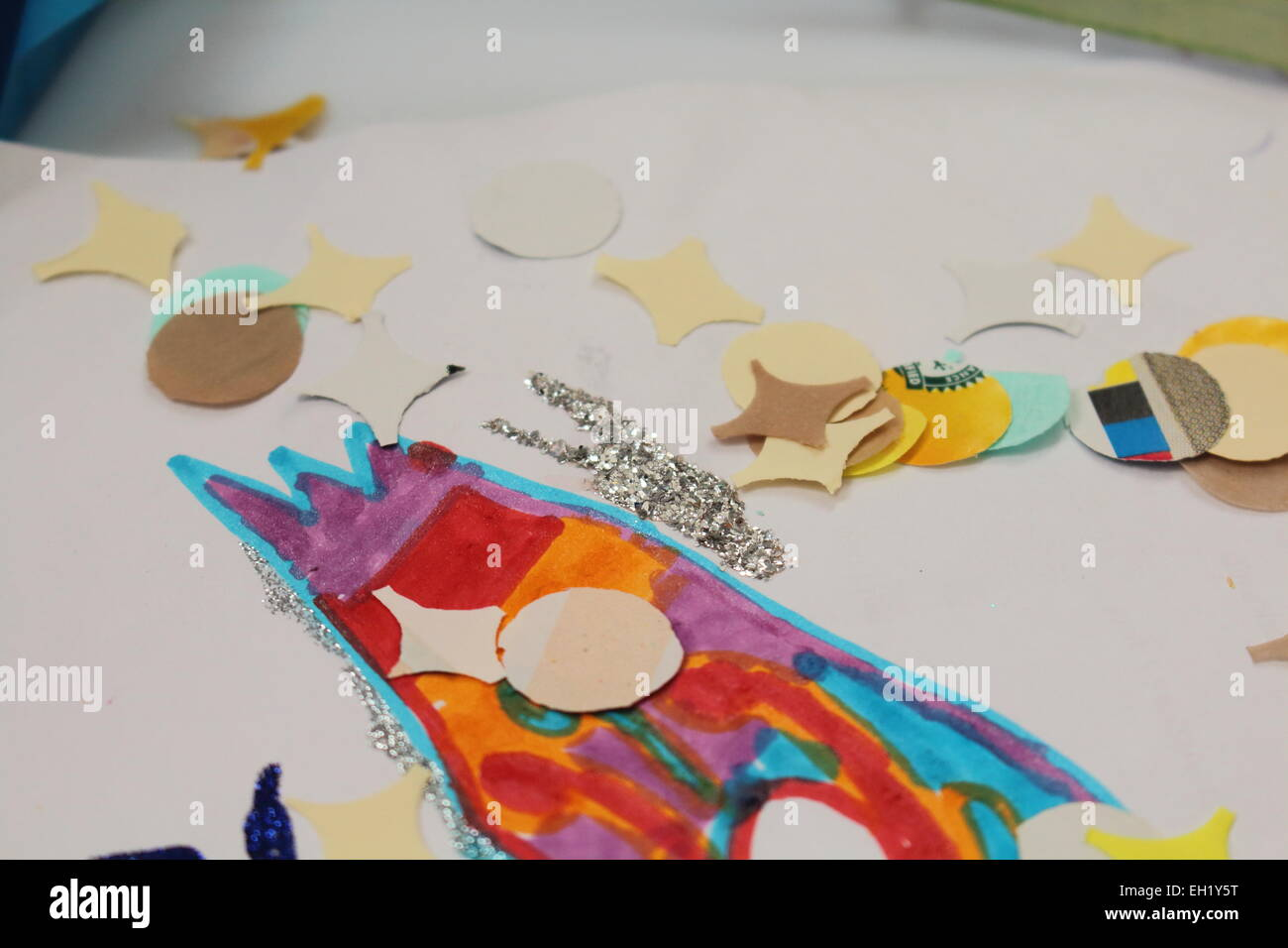 Children draw the carnival with markers, watercolors and