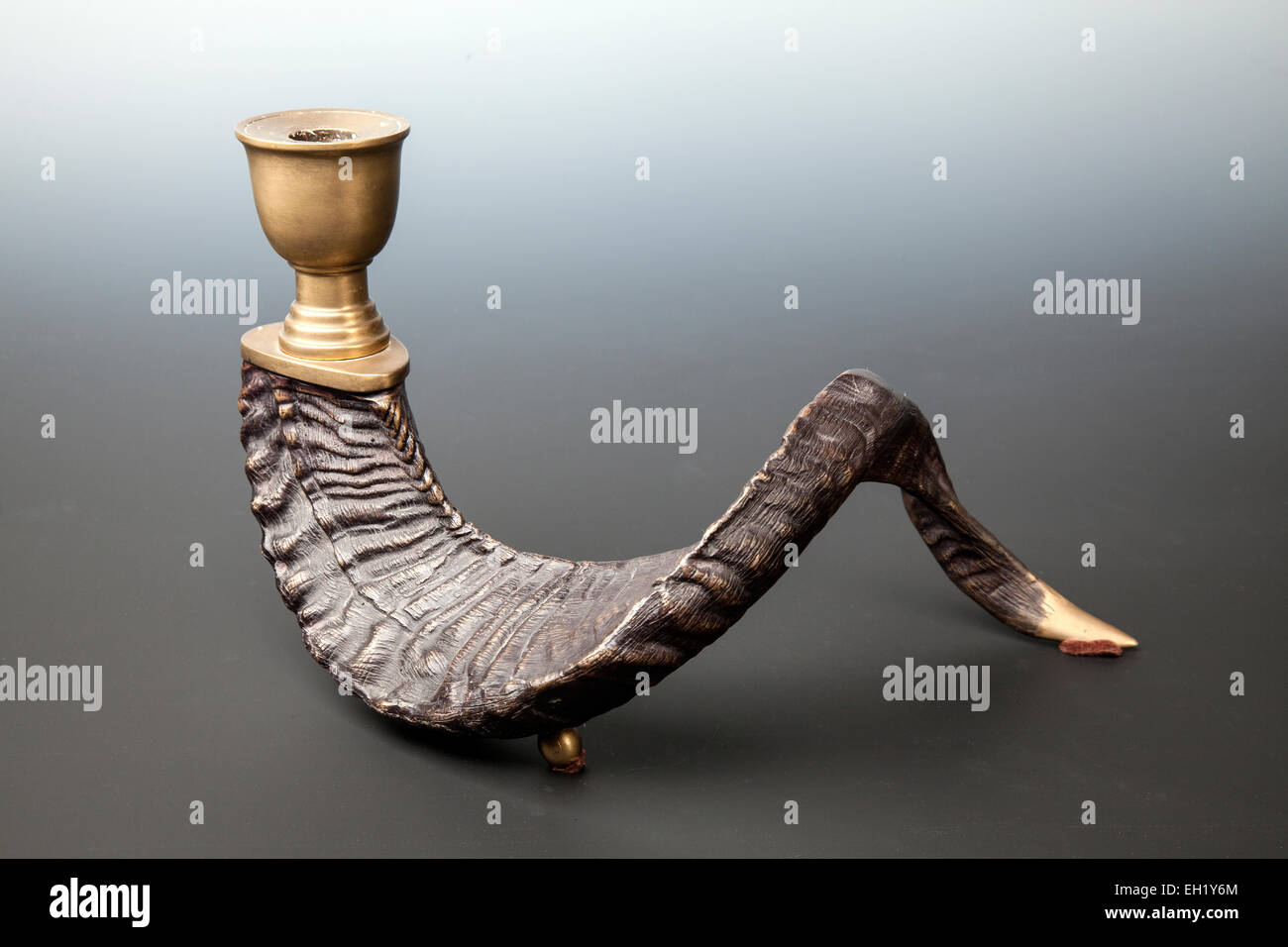 Vintage brass ram horn candle holders. - Stock Image