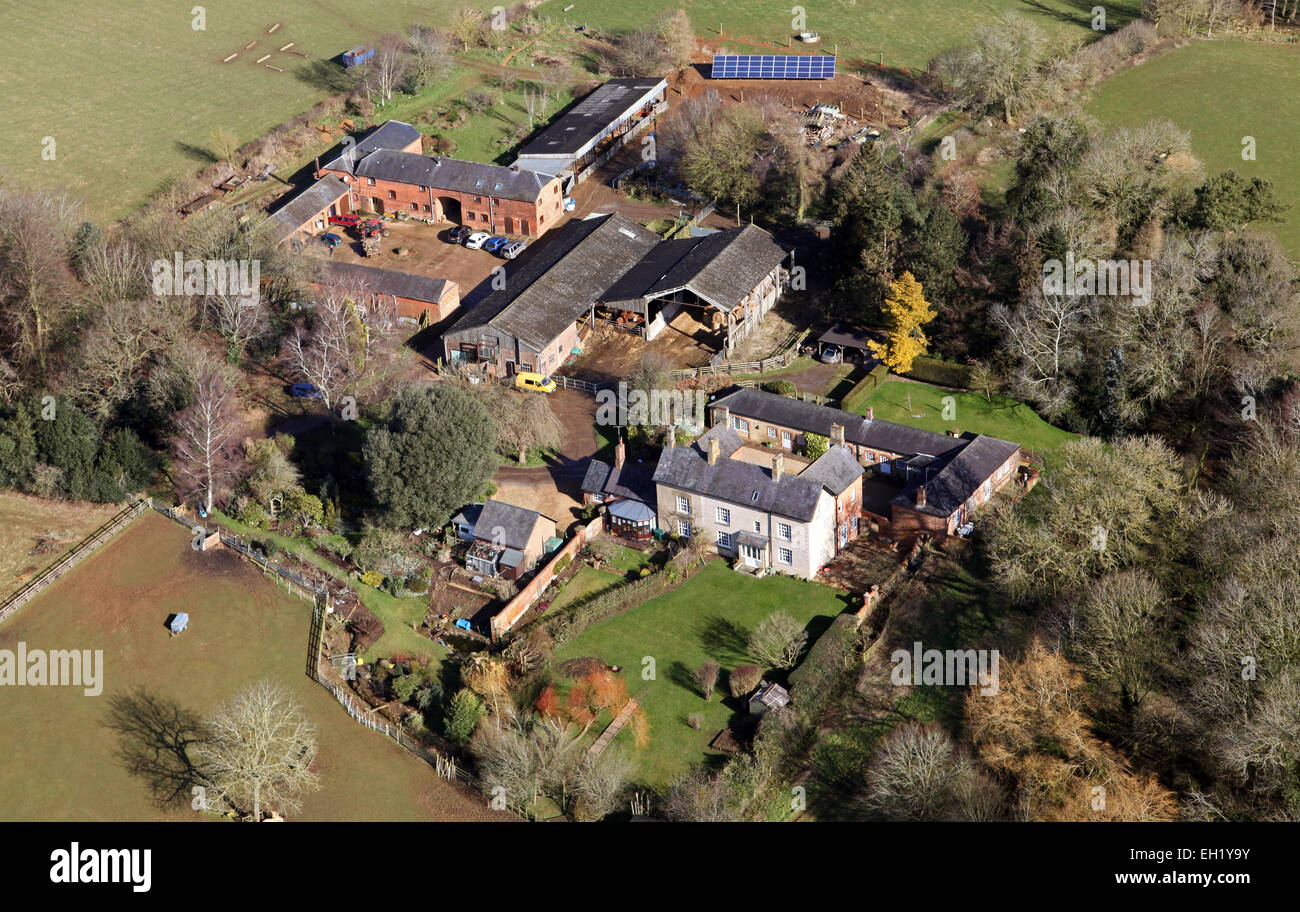 aerial view of an archetypal British farm with farmhouse and agricultural buildings - Stock Image