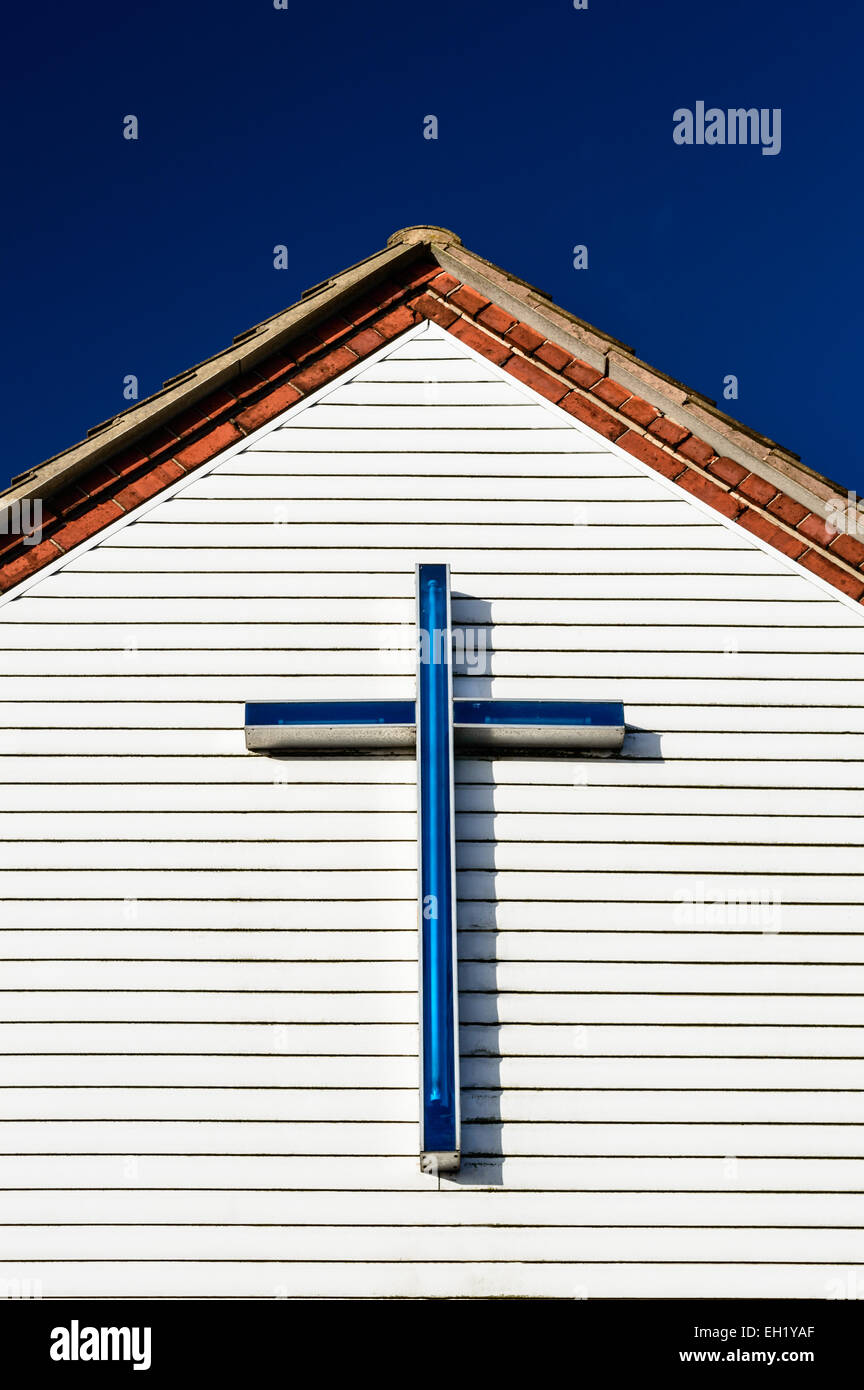 A blue cross/crucifix atop the eave of  St Wilfrid's Parish Hall in Kirkby In Ashfield, Nottinghamshire, England - Stock Image