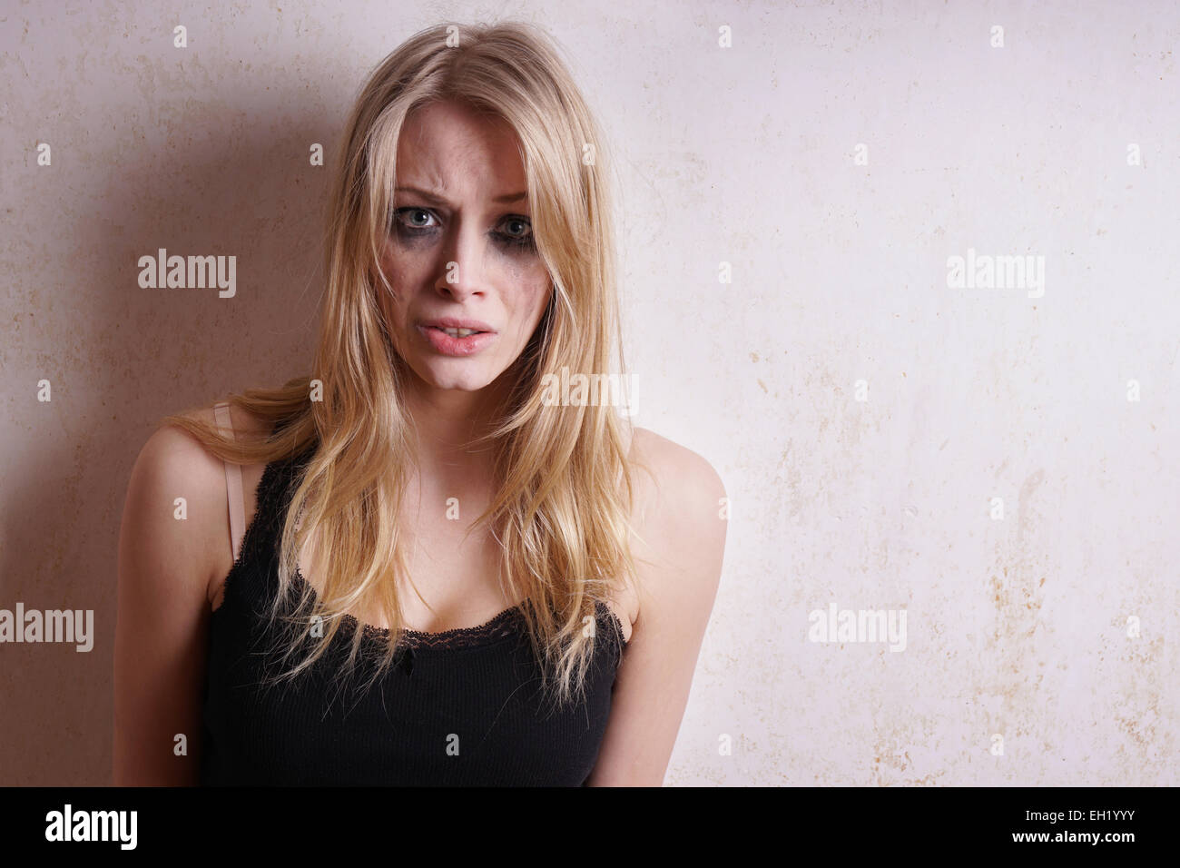 woman with smeared mascara - Stock Image