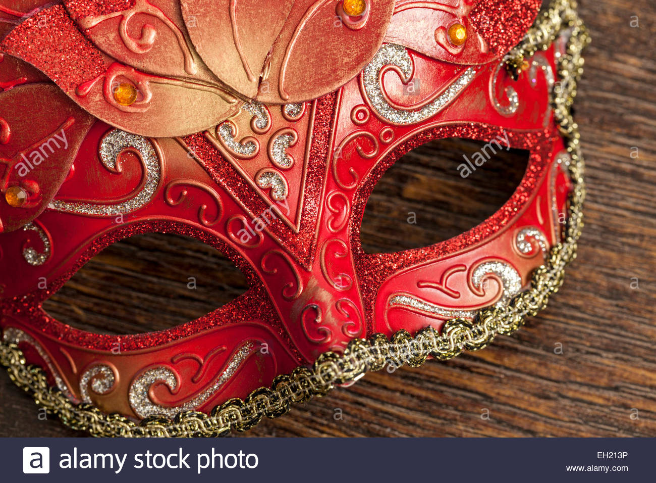 Red, gold and silver theatrical mask - Stock Image
