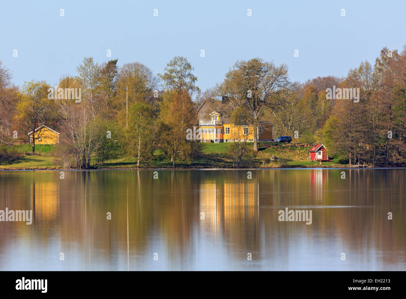 Houses on the hill by the lake in the spring - Stock Image