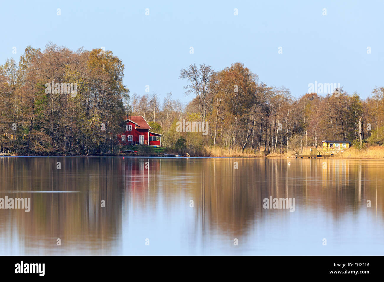 Houses at the lake in spring - Stock Image