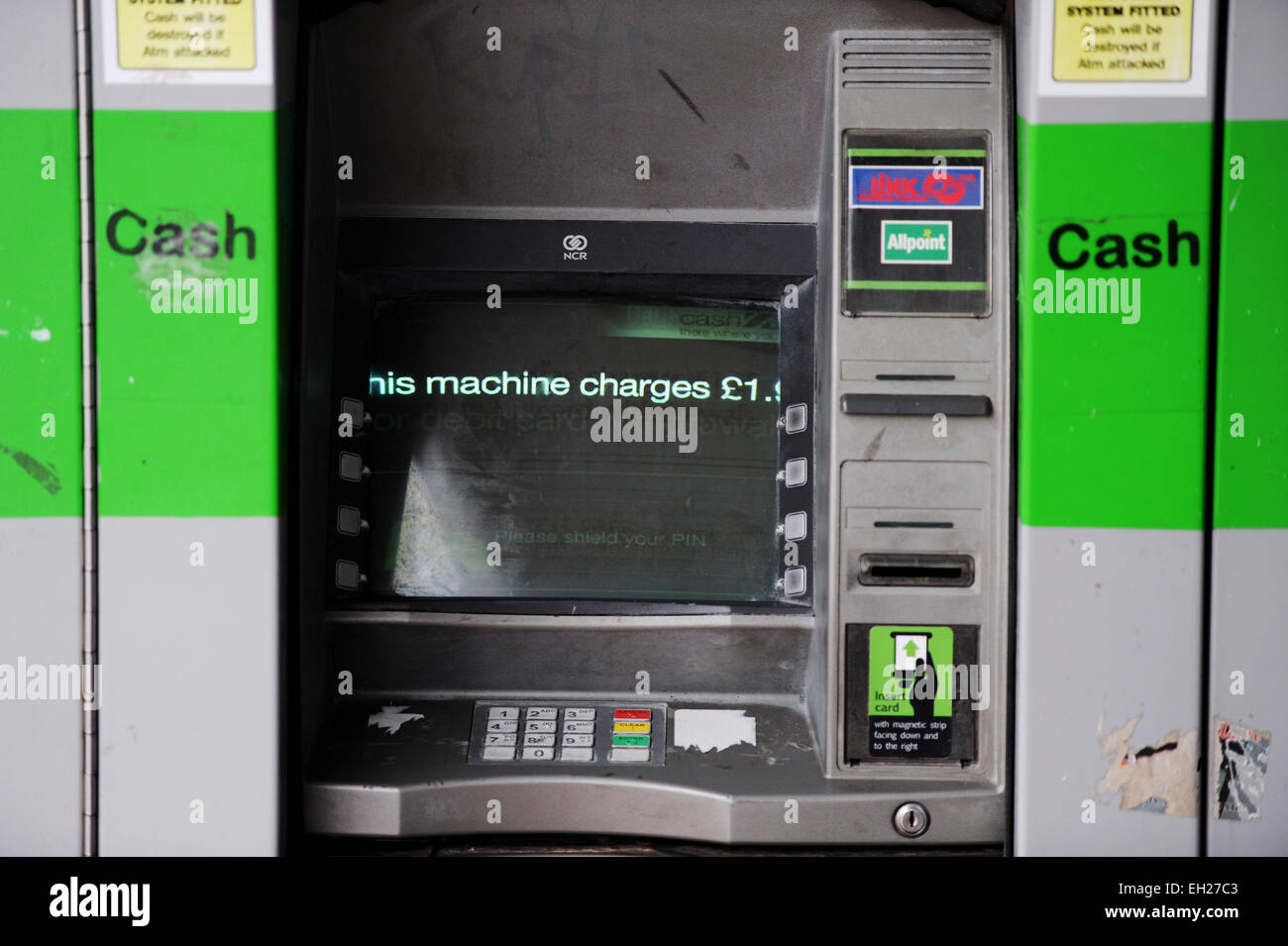 Tatty looking ATM cash machine that charges to make withdrawals Brighton UK - Stock Image
