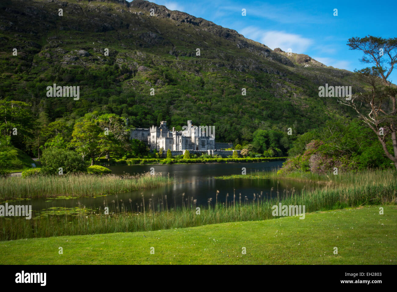 Kylemore Abbey from behind the lake, Connemara, Galway, Republic of Ireland - Stock Image