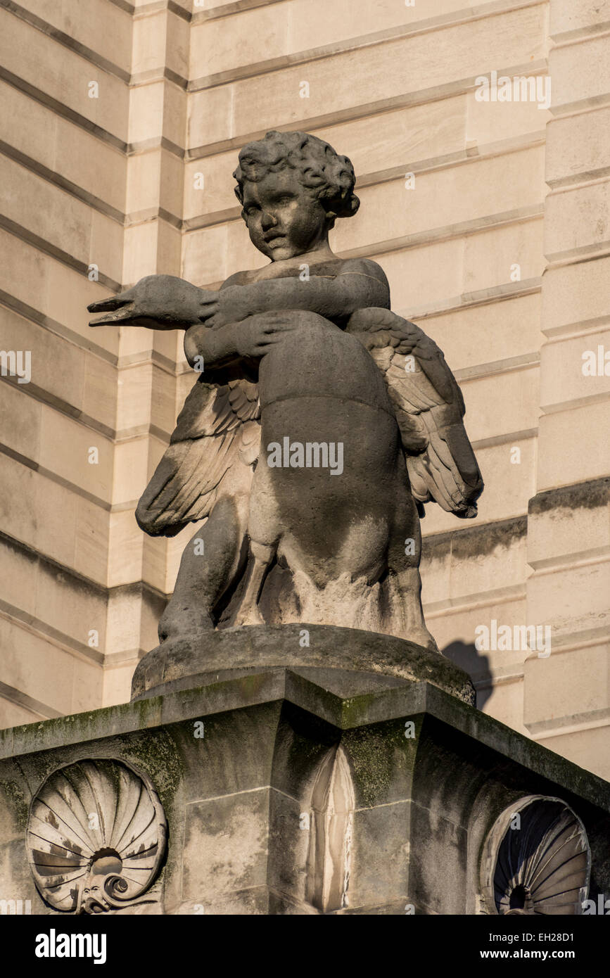 A sculpture of a boy holding a goose signifies the road Poultry in the City of London and historical roots as a - Stock Image