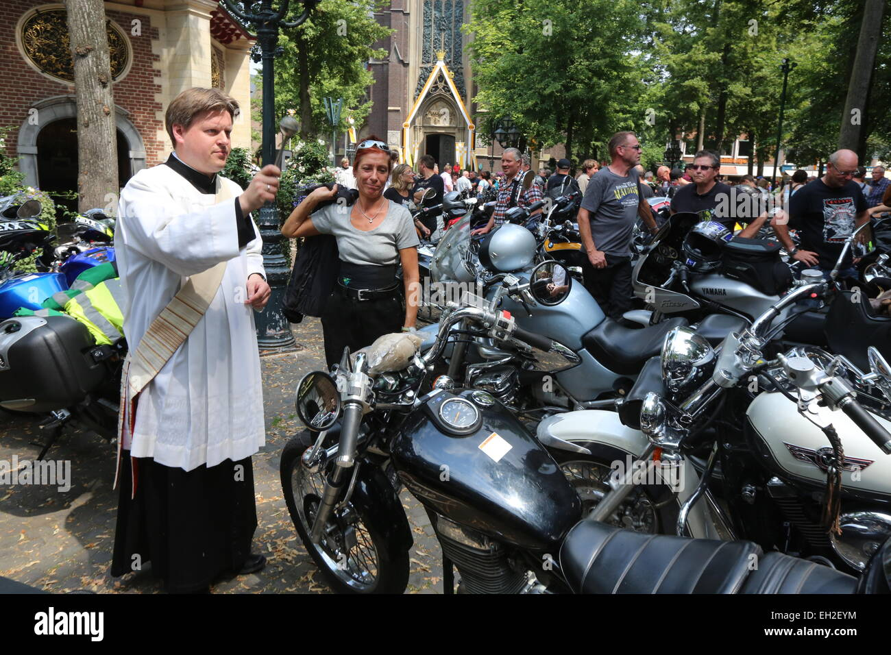 A priest blesses motorcycles and their riders during a motorcycle pilgrimage in front of the Chapel of Grace, Kevelaer, - Stock Image