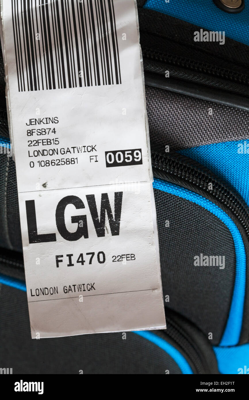 luggage label stuck on case for LGW London Gatwick airport - Stock Image