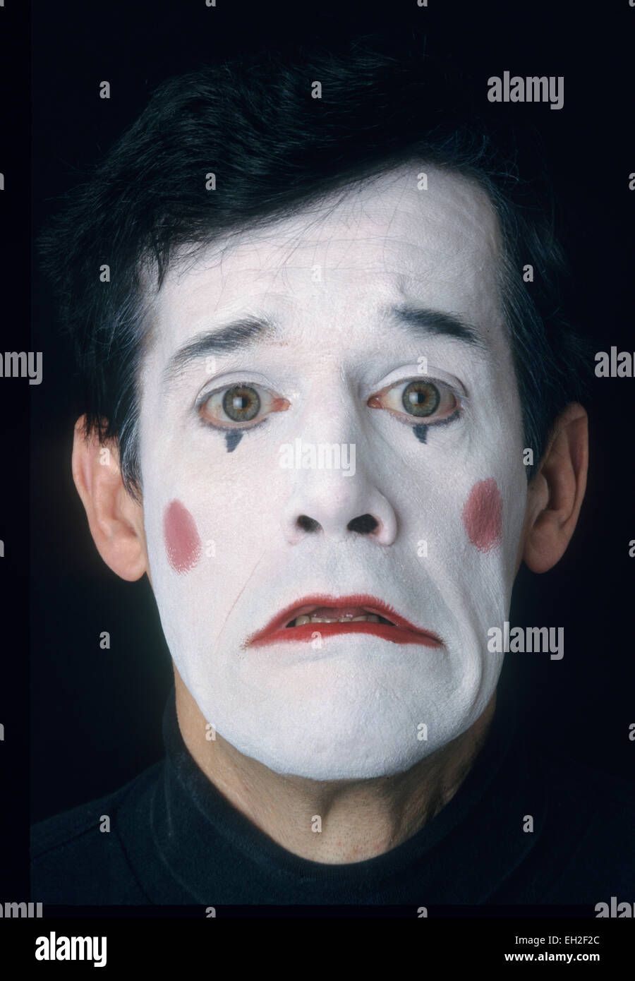 Mime, male, in white face, displaying fear or sadness Stock Photo