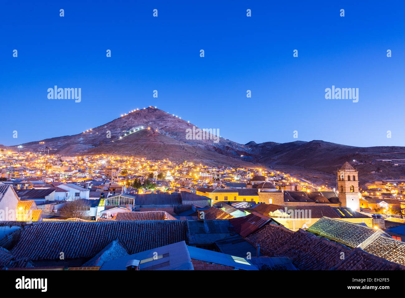 Historic center of Potosi, Bolivia at night with Cerro Rico in the background - Stock Image
