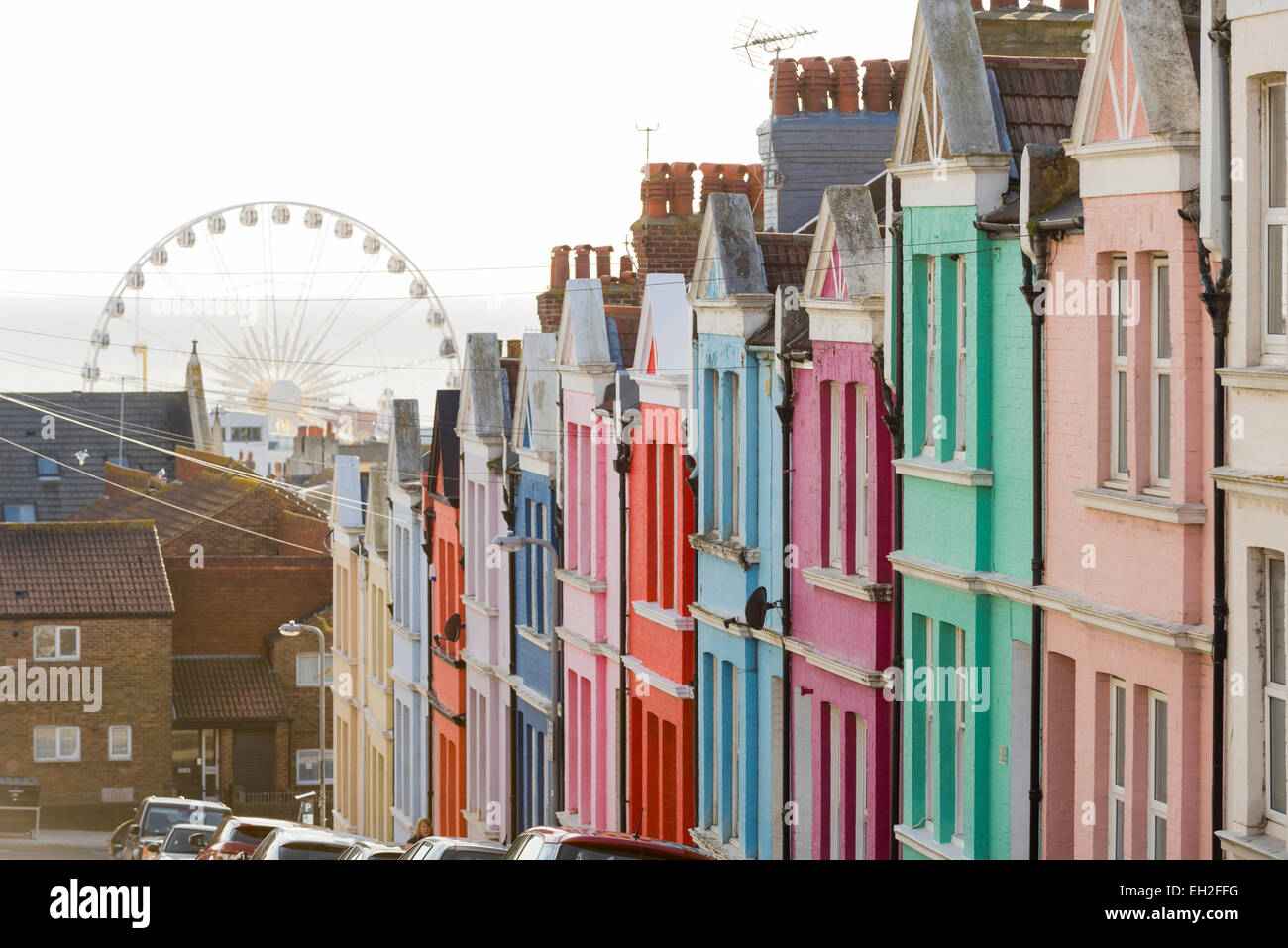 Row of colourful painted terraced houses in Brighton, East Sussex, England, UK. - Stock Image