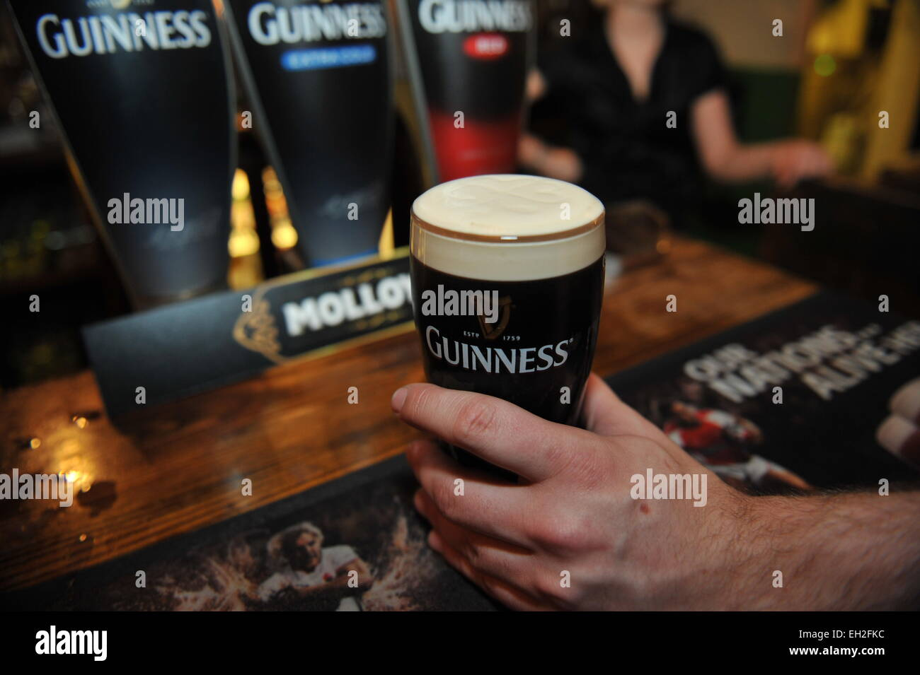 Pint of Guinness is pulled in a local pub, Lancashire. - Stock Image