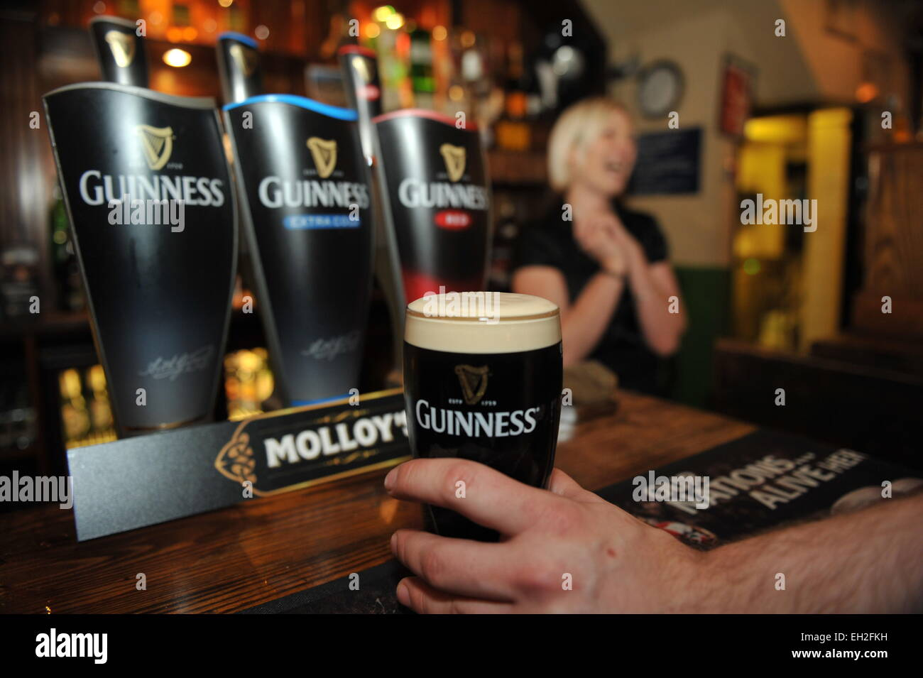 Pint of Guinness is pulled in a local pub, Lancashire. Stock Photo
