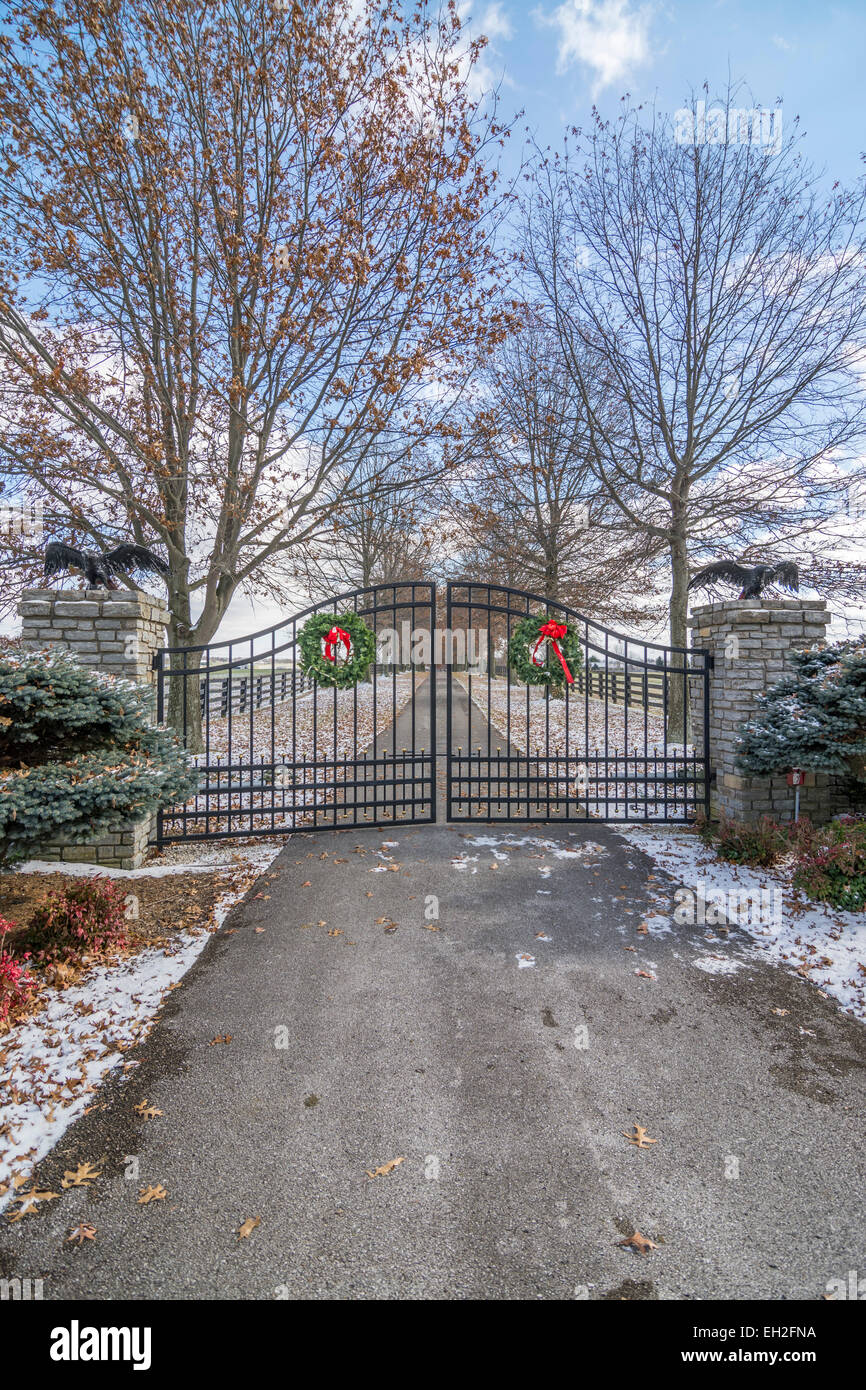 Gate to a horse farm with a Christmas holiday wreaths in the Stock ...