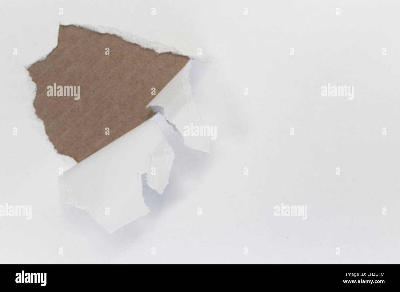 abstract background - ripped white sheet of paper over colored background - Stock Image