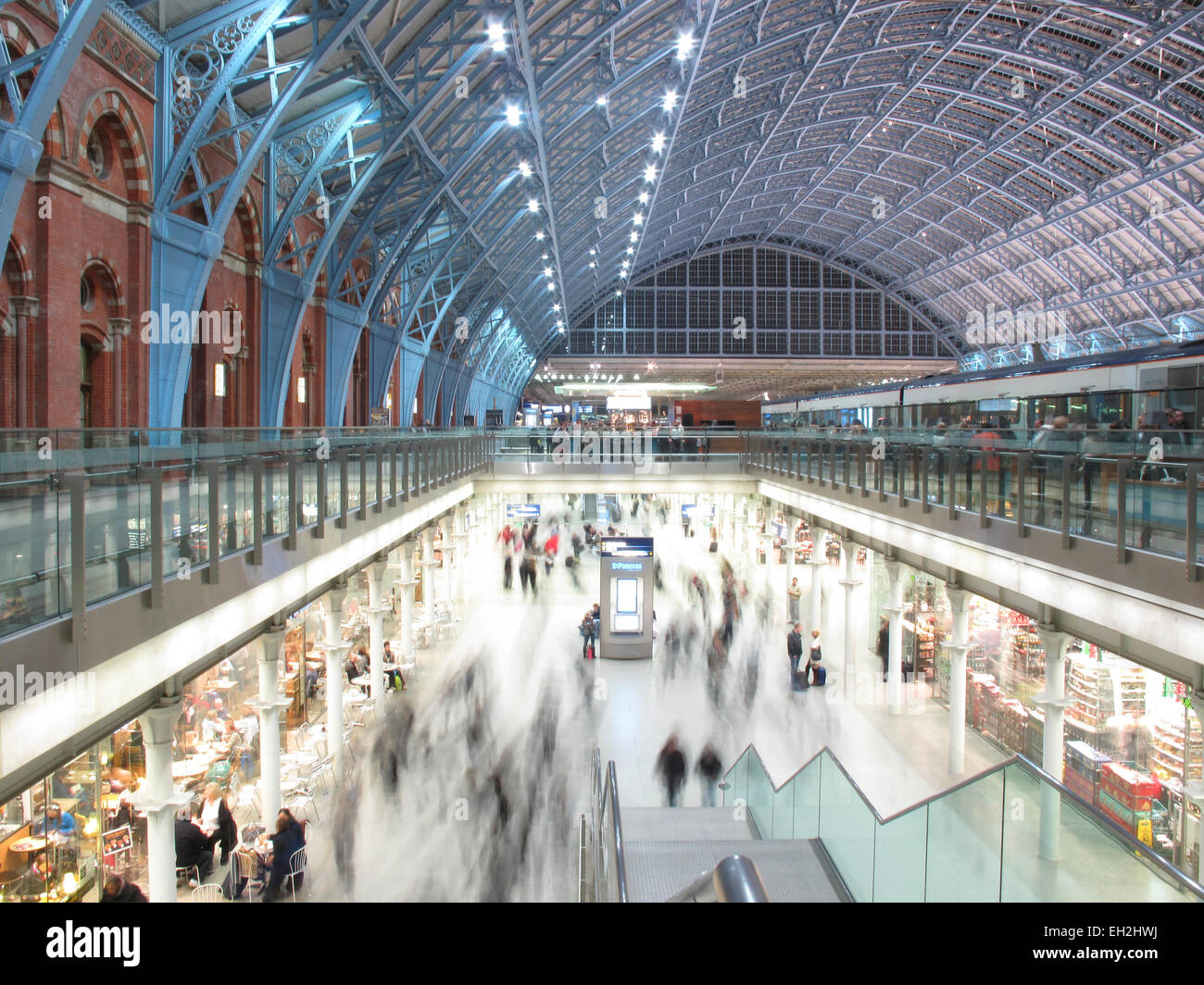 Travellers and shoppers at St Pancras station London - Stock Image