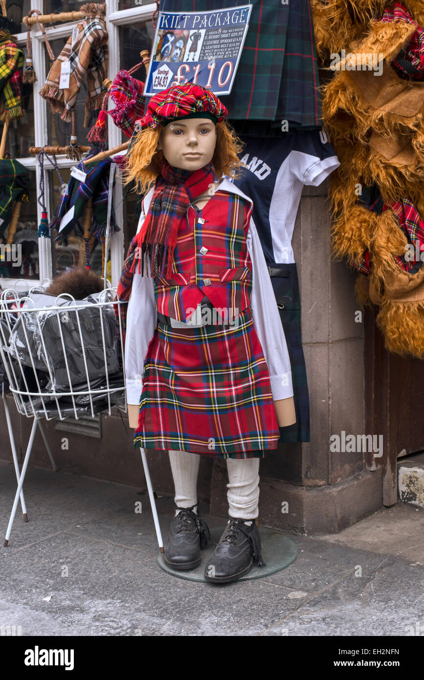 A child mannequin dressed in tartan oustide a tacky tourist shop on the Royal Mile in Edinburgh, Scotland, UK. - Stock Image