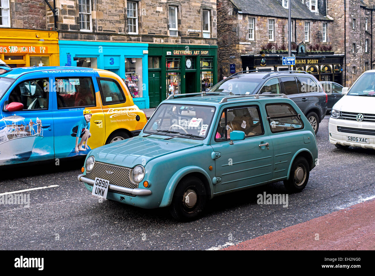 A Nissan Pao, a retro-styled automobile from Nissan Motors, sitting in traffic on George IV Bridge in Edinburgh, - Stock Image