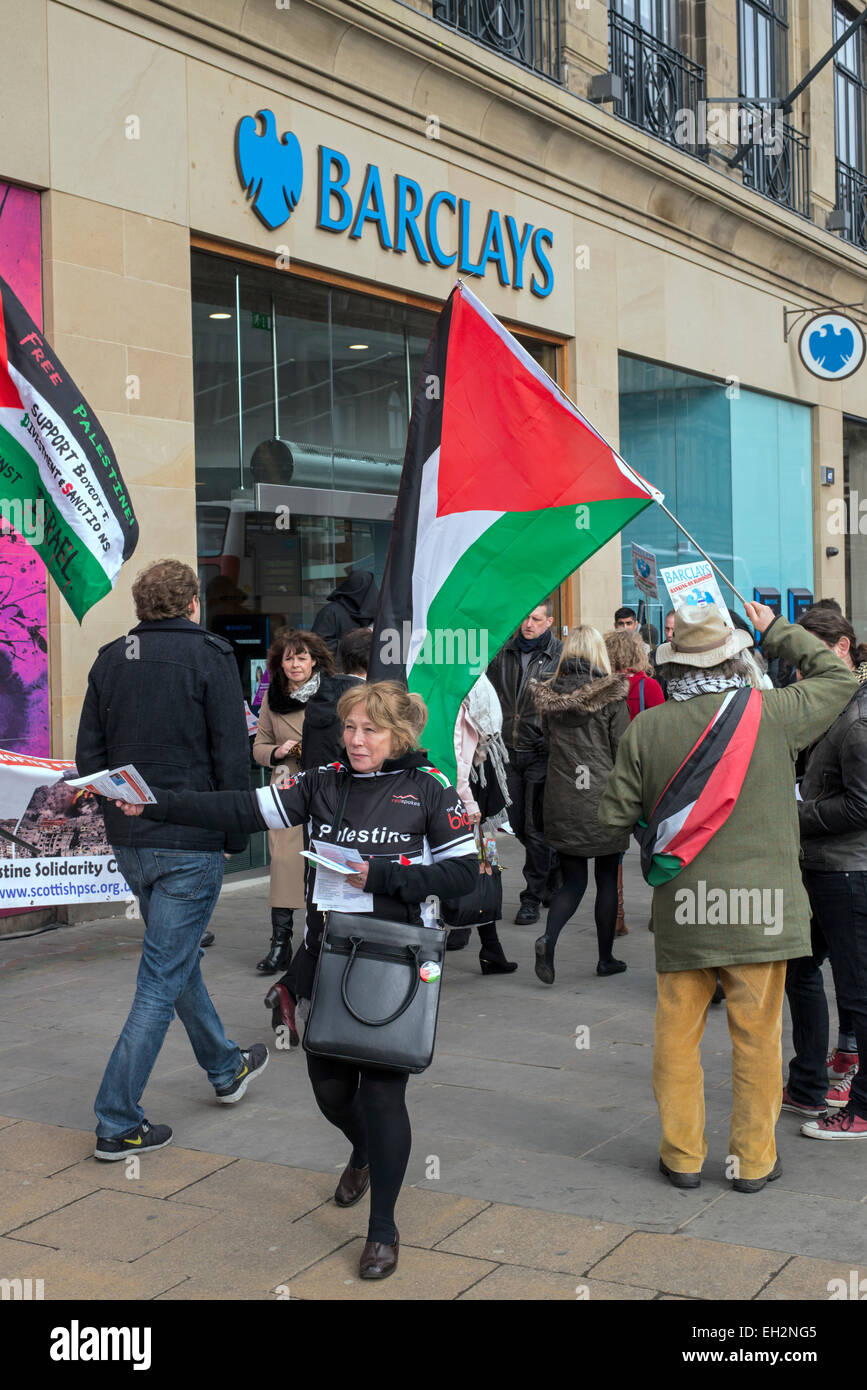A pro-Palestinian protest being held outside a branch of Barclays Bank on Prince Street, Edinburgh, Scotland, UK. - Stock Image