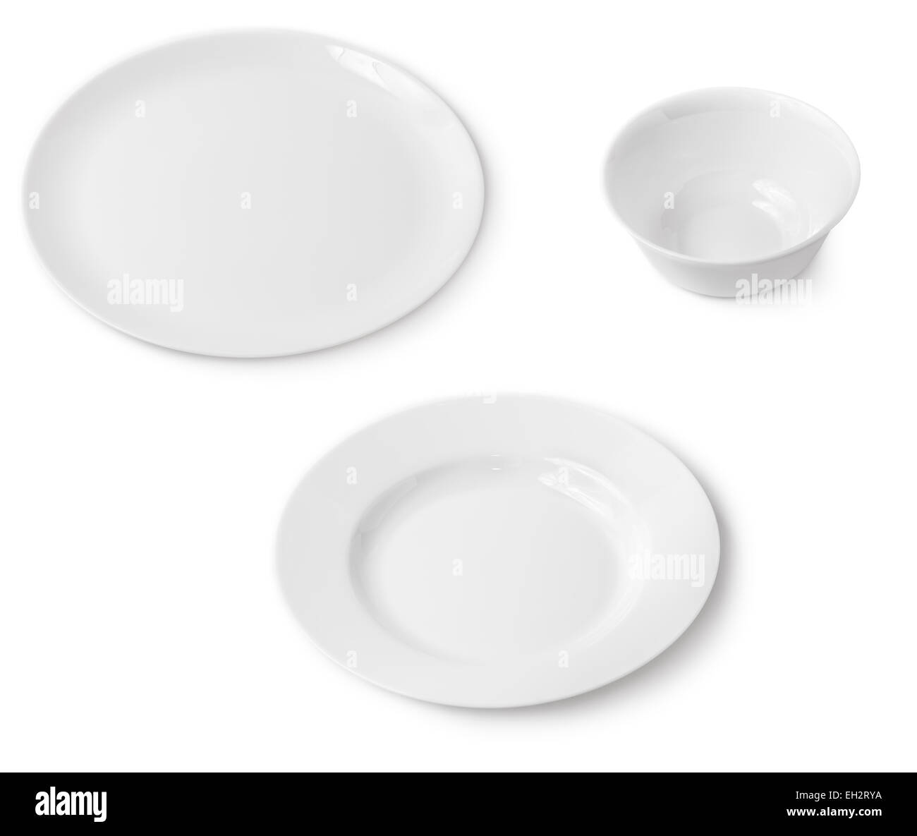 Clean white plates and bowl. Isolated on white background. - Stock Image