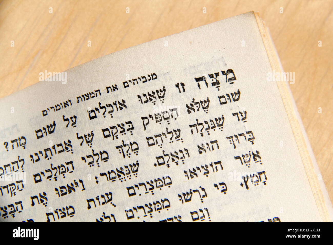 Closeup of Hebrew text  in traditional vintage Passover haggadah 'Matzah We eat...'.Judaic Related - Stock Image