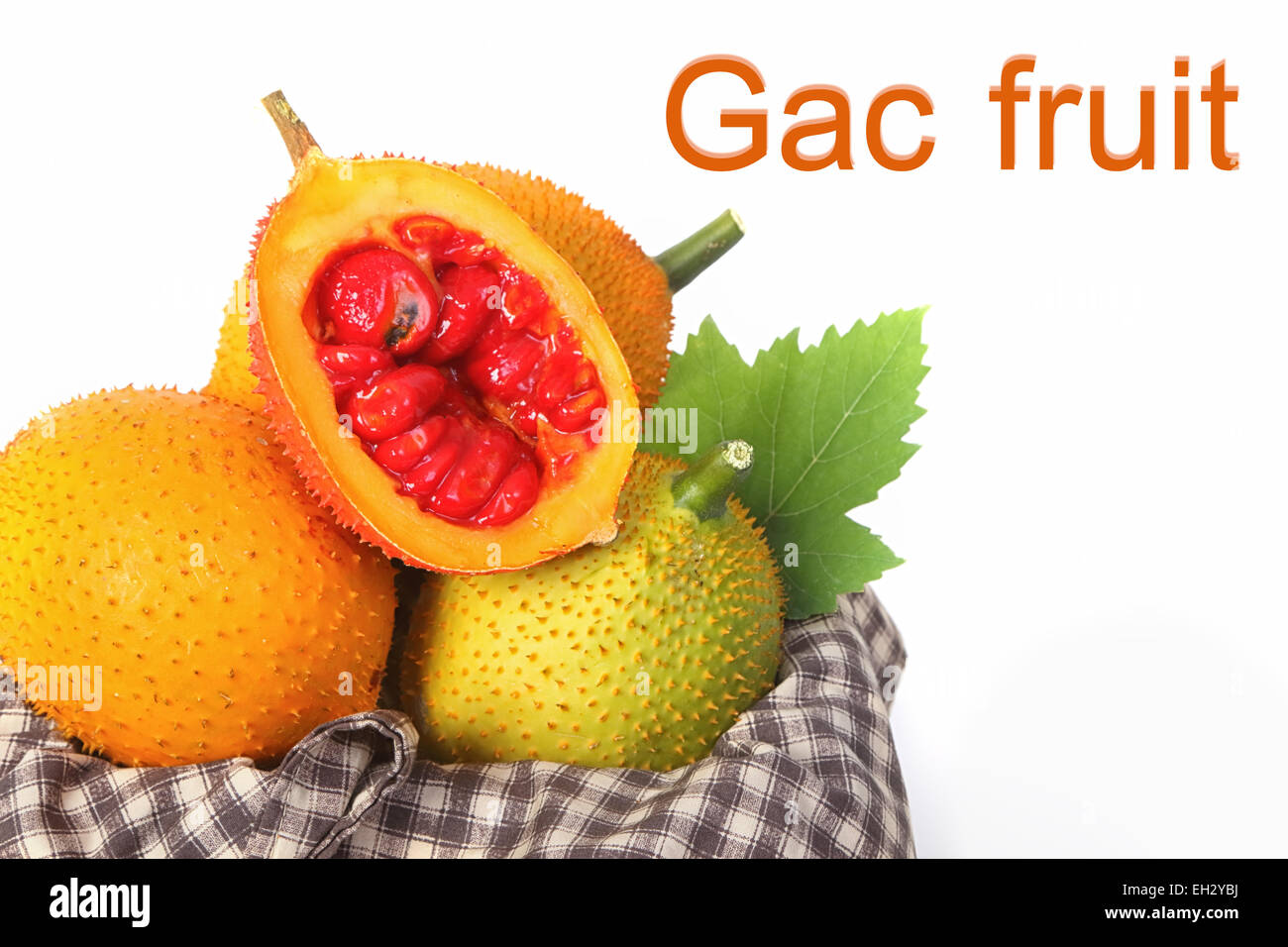 Gac fruit, Baby Jackfruit, Spiny Bitter Gourd in wooden crate - Stock Image