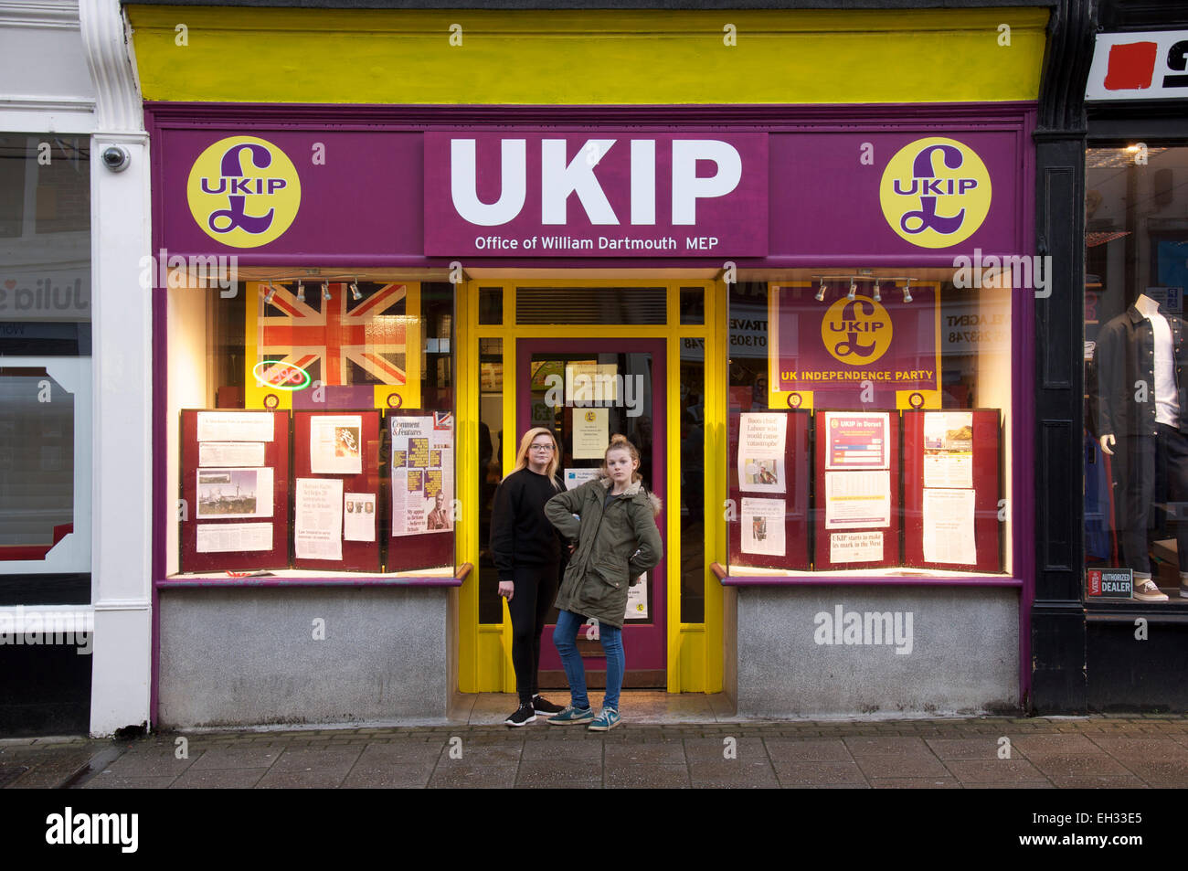 Politics. Two teenage girls pose in the doorway of the local UKIP branch office (United Kingdom Independence Party) - Stock Image